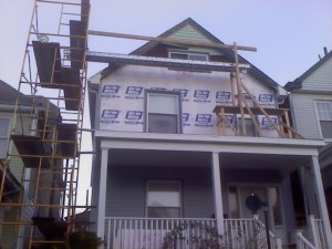 On this build we built two new porch roofs, and installed new siding.